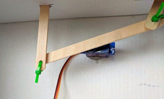 Zip tie connecting popsicle sticks