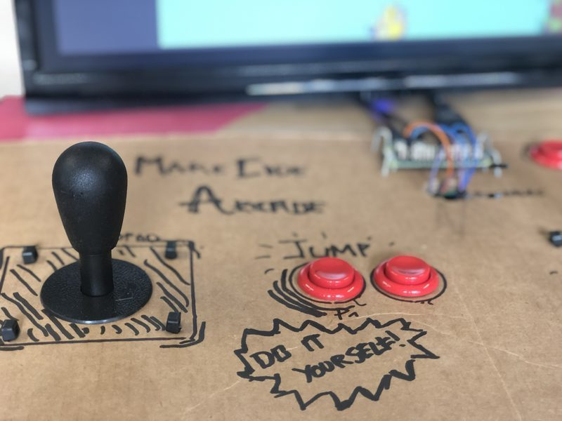 An Arcade control panel made of cardboard