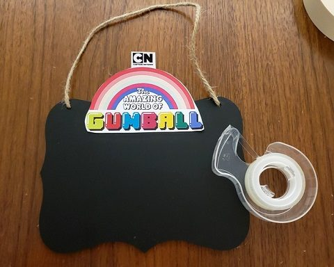 Gumball logo taped to the chalkboard piece