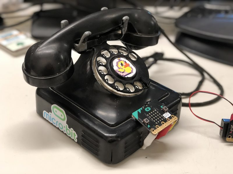 A rotary dial phone connected to a micro:bit