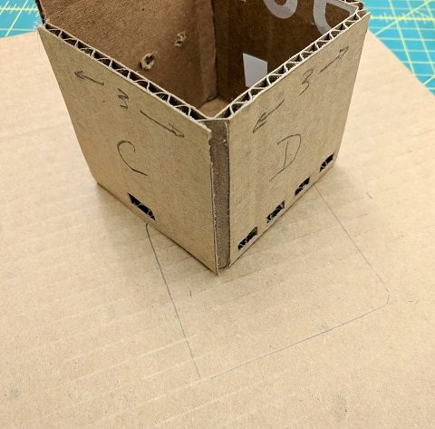 Position the box on the base