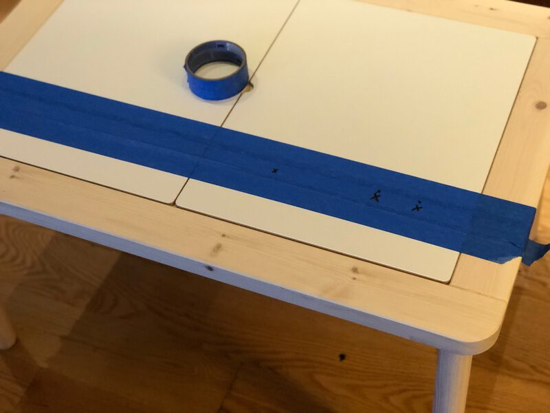 A table with masking tape and drill points