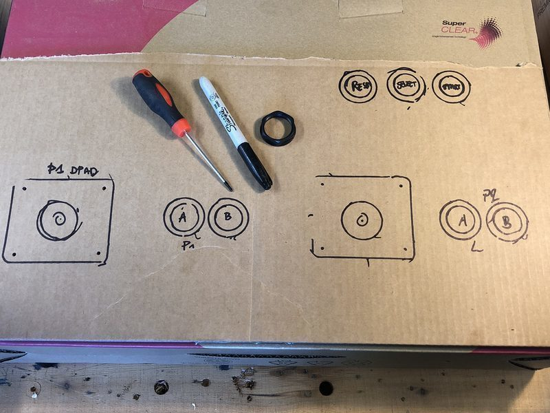 Button and joystick layout drawn on the cardboard