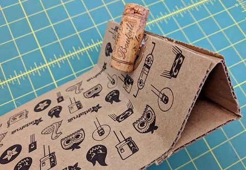 Fold in the cardboard and a cork to hold the board