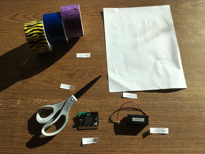 Materials: paper, tape, scissors