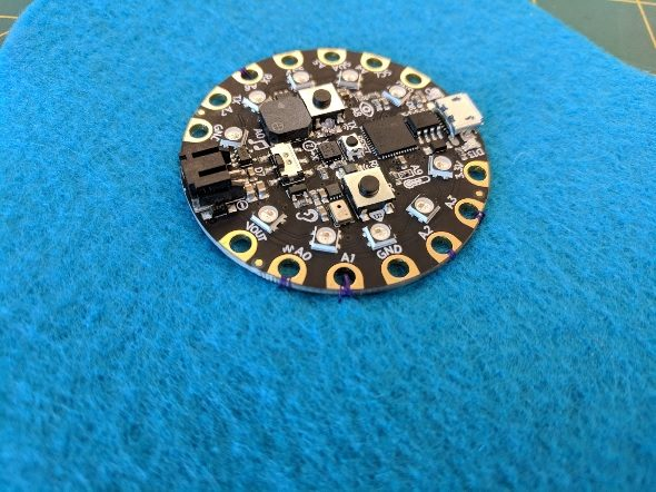 Sew on Circuit Playground through pin the port holes