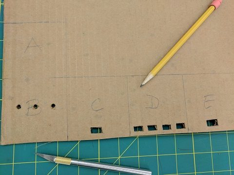 Plan the sides of the box on one piece of cardboard