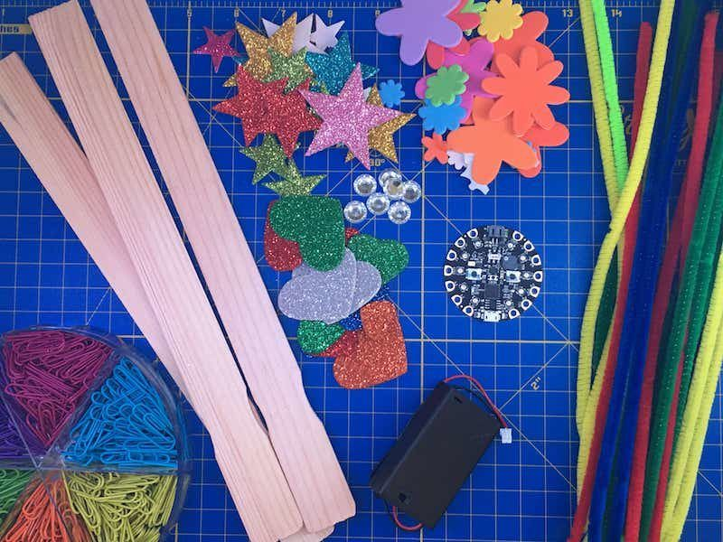 Materials: pipe cleaners, markers, tape, wooden craft stick, stickers