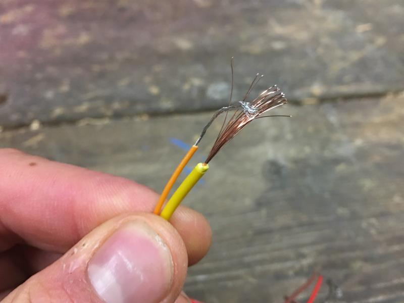 Bare wires place together before threading