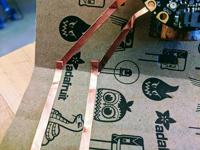 Folding copper tape over to make a turen