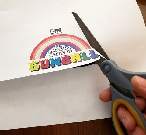 Cutting out the printed Gumball logo