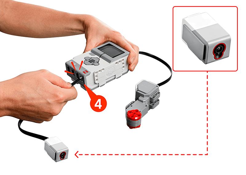 Hand connecting Color Sensor to Port 4, Large Motor D, EV3 Brick