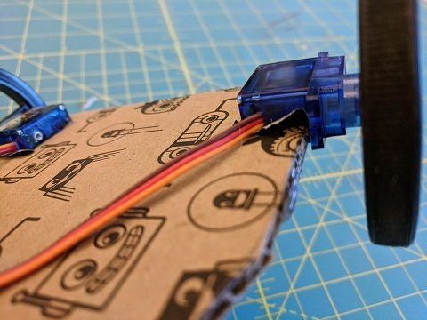 Servo motors affixed to the notches in the front of the robot