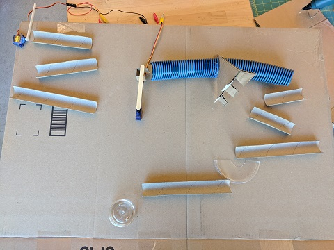 Plan out your marble run on a flat piece of cardboard first