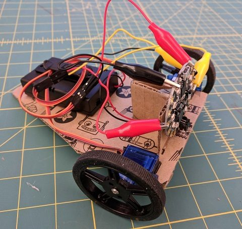 Attach Circuit Playground Express board to the stand at the front of the robot