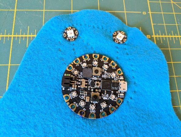Face of fabric friend with CPX and NeoPixels