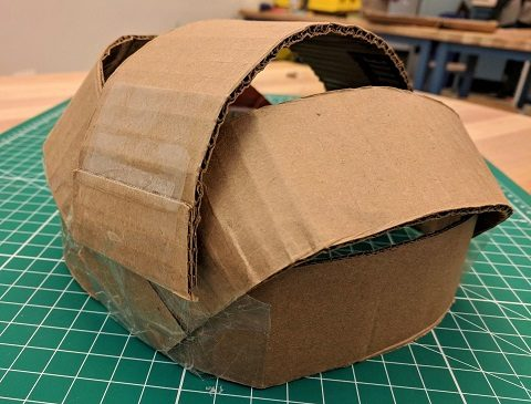 Cardboard strips overlapped making a shell