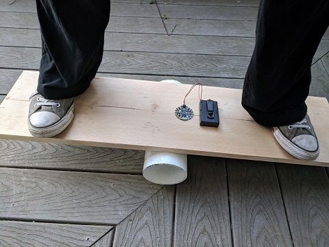 Rob standing on a completed balance board