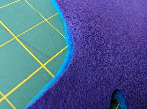Trim both sides of fabric to match